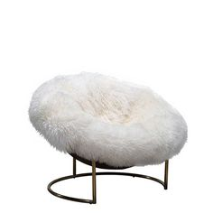 Covered in long-haired New Zealand sheepskin, the untamed Cave chair makes a great little cocktail chair for nights in with friends.