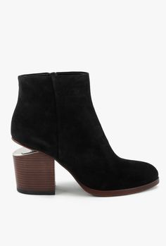 "Mid heel ankle suede bootie with inside covered metal zipper. Signature cut out heel with rhodium metal hardware. Leather stacked heel and polished leather outsole.       - 3"" heel   - Leather   - Imported"