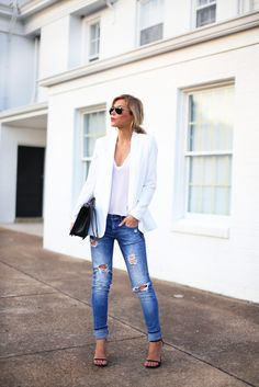 Mary Seng is wearing a white blazerand T-shirt from Nordstrom, jeans from Zara, shoes from Stuart Weitzman, sunglasses from RayBan and the bag is from Chanel