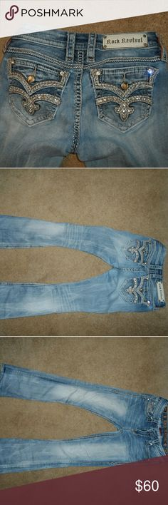 Rock Revival Karla midrise boot cut jeans size 26 Bling pockets, super cute jeans. There's a distressed part on the left upper leg. Not noticeable unless up close.  Message for a pic. Rock Revival Jeans Boot Cut