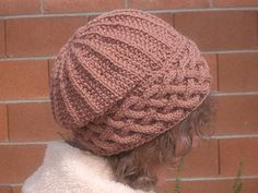 Song of Peace Hat is a unique knit hat with a featured cabled brim.