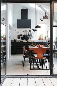 Black kitchen features add a modern feel to this open space. Would you want a kitchen like this?