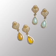 These turquoise (aquacelci), pear-shaped drop earrings with gold-plated and cubic zirconia detailing embrace the elegance of Princess Jasmine before she escaped the palace.  You will want to escape your house too once you slip these beauties on. (Also available in yellow celci)    To get all the glitz & glam shop http://modlife4.me