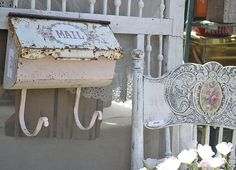 love the white on the chair with the flower in the center of the pressed back  -the vintage marketplace