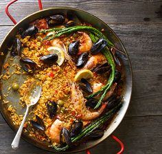 This Grilled Seafood Paella With Manzanilla Olives, Mussels & Shrimp recipe is featured in the Spanish Food feed along with many more. Grilled Seafood, Fish And Seafood, Fresco, Paella Valenciana, Spanish Cuisine, Spanish Food, Seafood Paella, Paella Recipe, Risotto