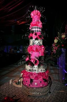 Gorgeous tall tiered cake in black pearl and hot pinks!  Cynthia's Cakes by Cynthia Ebrom. Edinburg Texas   Photo by Frank Martinez McAllen TX.   Cynthiascakes.com