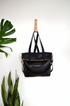 Hey, I found this really awesome Etsy listing at https://www.etsy.com/listing/238931417/3-in-1-black-pebbled-leather-backpack
