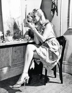 Burlesque dancer, Julie Bryan gets made up before a performance, 1948