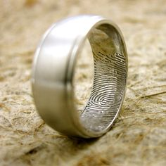 Wedding band  for husband with wife's fingerprint :) Love this idea