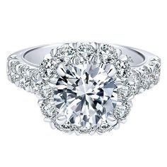 18K White Gold French Pave Large Halo Diamond Engagement Ring. This ring features 1.86cttw of round diamonds with a substantial diamond shank of french pave set round diamonds. Features a stunningly large round halo design accenting a 2ct round center diamond. All diamonds are F/G in color and SI in clarity. Price is for mounting only. Also available in yellow or rose gold, and platinum, either two-tone or single metal. Designed by Gabriel & Co. #325A