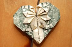 How to Fold a Dollar Into a Heart (courtesy of @Camilledxw557 ) this would be fun to do for Missionary Wives at our conference! But use $100.00 bill!