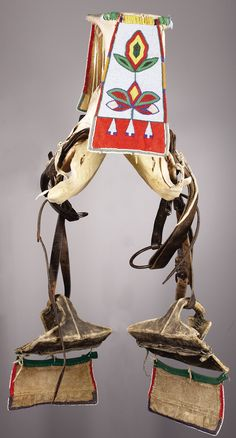 A CROW WOMAN'S BEADED HIDE PARADE SADDLE. c. 1900. ... American | Lot #77301 | Heritage Auctions