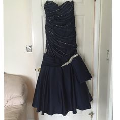Jovani Evening Gown with Swarovski crystals Navy blue dress worn ONE TIME as a mother of the bride dress.  In brand new condition! Size 12/14. Comes with shrug. Gorgeous Swarovski crystals on dress. Such a great deal! Jovani Dresses