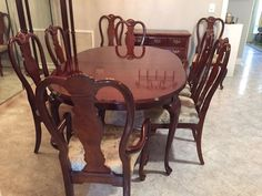 """Used (normal wear) - $350 Cherry wood finish DR Table: 44""""d x 65""""l x 30""""h, purchased at Haverty's; including 2 table leaves 18"""" w each, 2 armchairs and 6 side chairs."""