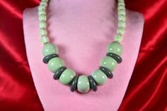 Light green, white and gray come together soothingly in this funky, chunky graduated bead necklace with a silver hook clasp and findings. $25 at #SmallestPlanet on #Etsy. Get 15% off your entire purchase with coupon code PIN15.