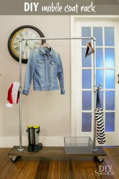 DIY rustic/industrial galvanized pipe and wood freestanding, mobile coat rack on casters @diyshowoff #lowescreator
