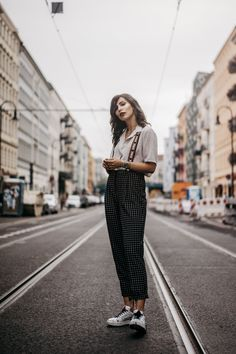 White shirt+black checked pants+white sneakers. Late Summer Casual Outfit 2017