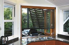 This Stegbar timber bi-fold windows is from the same company that supplied the windows for my conservatory. It includes a fly-screen but costs about $3,000!