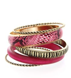 With shades of pink and gold in delicious designs, these bangle set spells fun and passion.