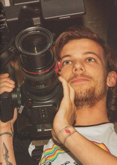 Louis Tomlinson lol shows how much I don't pay attention to there tattoos.. Can someone tell me when he got that one on his right wrist?
