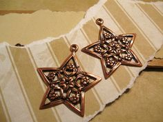 Floral Star Charms from Trinity Brass in by beadbarnsupplies, $2.00