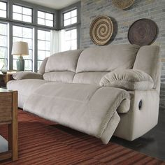 Tolette 2 Seat Reclining Sofa by Signature Design by Ashley Manual Type Overall Product Weight: 205 lb. Power Type Overall Product Weight: 236 lb. Other Dimensions Overall: 41'' H x 96'' W x 41'' D Seat: 21'' H x 66'' W x 22'' D Fully Reclined: 66'' D $1350 with power