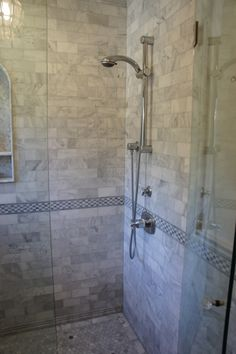 Carrara marble shower and bathroom