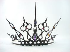 Can't be an Evil Queen without a wicked crown!!     Purple Gothique - Black Filigree Gothic Tiara - Ready to Ship. $50.00, via Etsy.