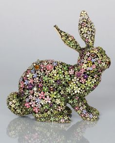"""Handcrafted bunny figurine. Limited edition. Cast pewter with a brass ox finish. Hand enameled and hand set with Swarovski crystals. 6.75""""W x 3""""D x 6.75""""T. Made in the USA."""