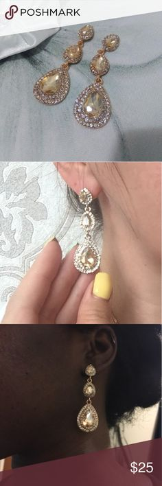 Champagne Tear Drop Earrings Beautiful champagne colored pear shaped cubic zirconia stones each surrounded by a double halo. Elegant and chic stud drop earrings with three tiers. Perfect for special events, birthdays, and weddings. Diamonds & Jules Jewelry Earrings