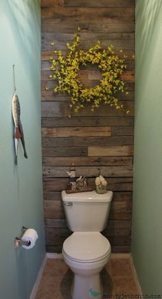 This half bath has a pallet wall... I like the idea but I am using only for inspiration- I would paint all the walls except the one with the toilet. Use wallpaper or a design on that wall.
