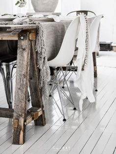 Sawhorse kitchen table legs. Unexpected detail.