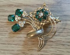 Hair clip barrette green and clear rhinestone gold tone