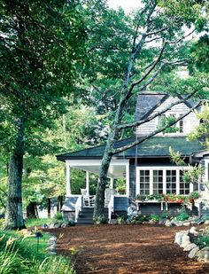 farmhouse. perfect driveway, tress, color...so lovely.