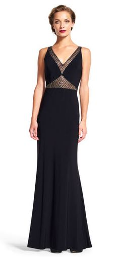 Stunning beading and sheer details give this evening dress the ability to shine the entire night through. Featuring sheer paneling at the front and back of the bodice with lines of hand-beading criss-crossing the mesh, this mermaid gown is stunning yet simple. This sleeveless long dress loves pairing up with simple metallic accessories for a gala-ready look.