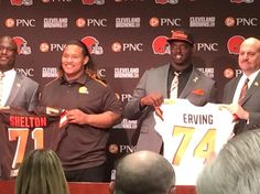 Draft picks Danny Shelton and Cameron Irving stand with coach Mike Pettine and general manager Ray Farmer. (Photo: P.J. Ziegler)