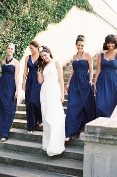 These navy bridesmaids dresses are gorgeous!  And I love that they're different tops so that the ladies can pick their favorites!