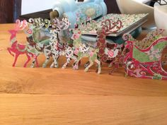 Let's go on a sleigh ride ........ The sleigh and reindeers are made with Brenda Walton's Bigz dies.