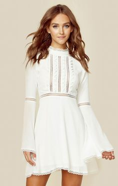 "The Willow Bell Sleeve Dress by For Love and Lemons features mock neckline with lace contrast, tiny ladder cutouts on the bodice, long bell sleeves, and floral trim. ImportedDry Clean OnlyRayon BlendFit Guide:Model is 5ft 7 inches; Bust: 32"", Waist: 24"", Hips: 34""Model is wearing a size XSRelaxed FitShoes Featured Not Available For Purchase"