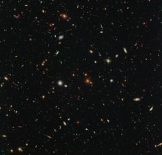 Thousands of colorful galaxies swimming in the inky blackness of space