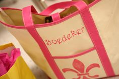 Super easy bridesmaid gift.  Buy a tote-bag from the dollar store and a stencil from any craft store.  Stencil the bag with acryllic paint, then have it embroidered.  Total project cost only 6 bucks per bag!