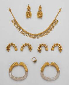Ganymede Jewelry Hellenistic 330-300 B.C. The pieces in this group were found together in Macedonia, near Thessaloniki, sometime before 1913. Although the assemblage forms an impressive parure (matched set)—earrings, necklace, fibulae (pins),...
