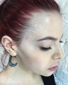 Subtle White Ink Tattoos Your Parents Won't Even Mind - TattooBlend Small Face Tattoos, Face Tattoos For Women, Small Flower Tattoos, Small Girl Tattoos, Large Tattoos, Tattoos For Women Small, Subtle Tattoos, Tattoo Flowers, Wing Tattoos On Wrist