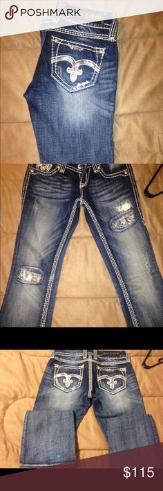 NWOT Rock Revival Jeans Alanis Style boot cut jeans. Never been worn pretty fade with sequin patches. Everything still intact no rips or stains. Size 25 tried on but a little too tight so they've been sitting in my closet. May be willing to trade. 😊 Rock Revival Jeans Boot Cut