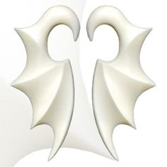 Pair of Hand  carved buffalo bone bat wing tapers