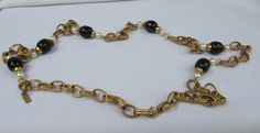 SOLD !Vintage YSL belt/necklace - gold tone chain with faux pearls and bakelite beads - an exceptional piece -