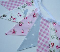 Shabby Chic Style Bunting - Birdtrail, Pink Rosebud, Gingham and Dotty. This charming country style bunting is made out of four coordinating pretty cotton fabrics. This would look lovely in any room especially a girls bedroom or would make a great gift.