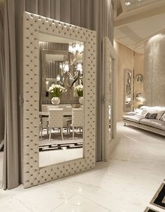 Large mirror in hotel room to add feeling of space and lavishness