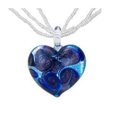 Elegant and stunning, blue heart shaped Murano Glass Necklace on a 16 inch silver chain. Swirls of dark blue within make this Blue Heart the highlight of any outfit for a quiet date night or a black tie event.
