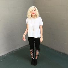 A simple white tee and black jeans becomes boho chic with red lips and embroidered boots!
